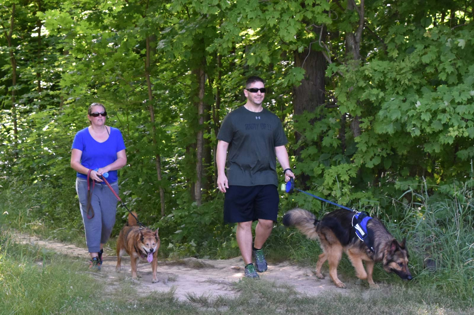 Visitors walk their dogs at Scioto Grove.