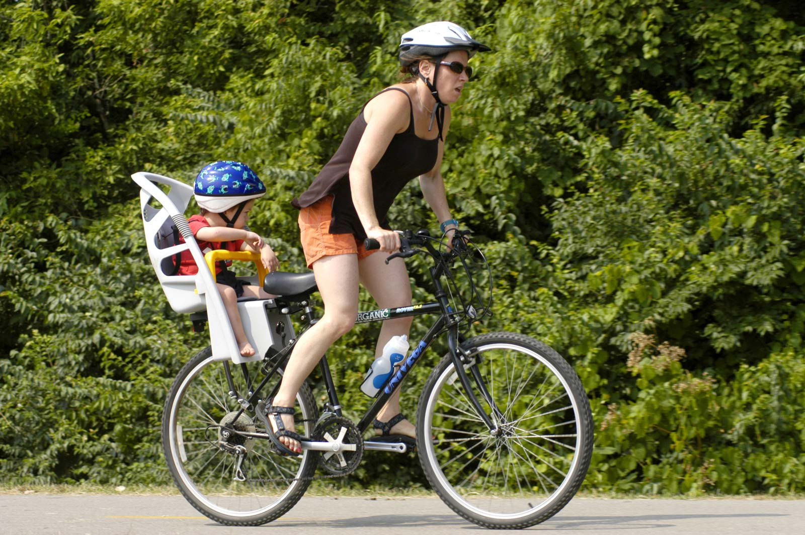 Woman and child riding bike in Sharon Woods.
