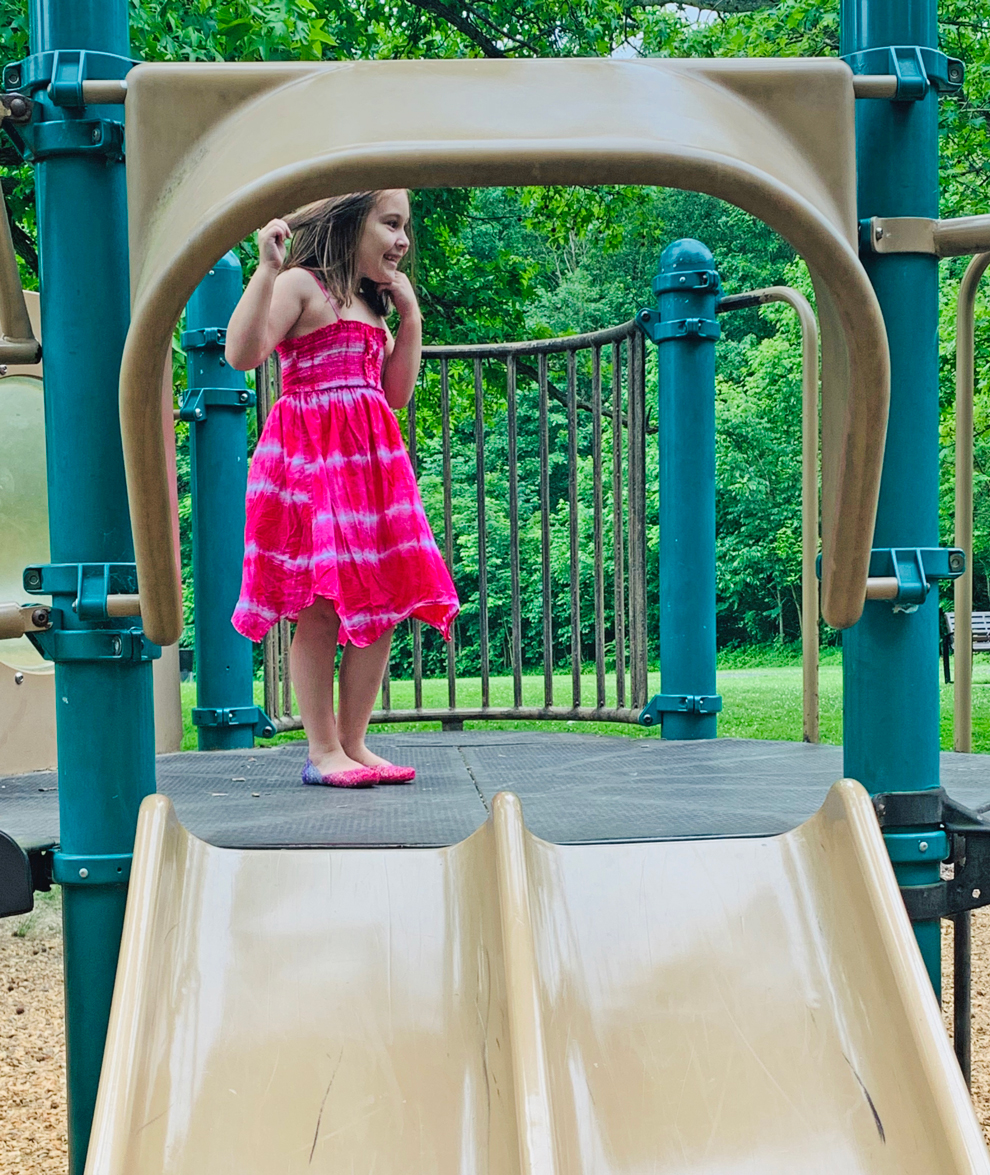 Aurora Crea plays on the slide at one of the Battelle Darby Creek play areas.