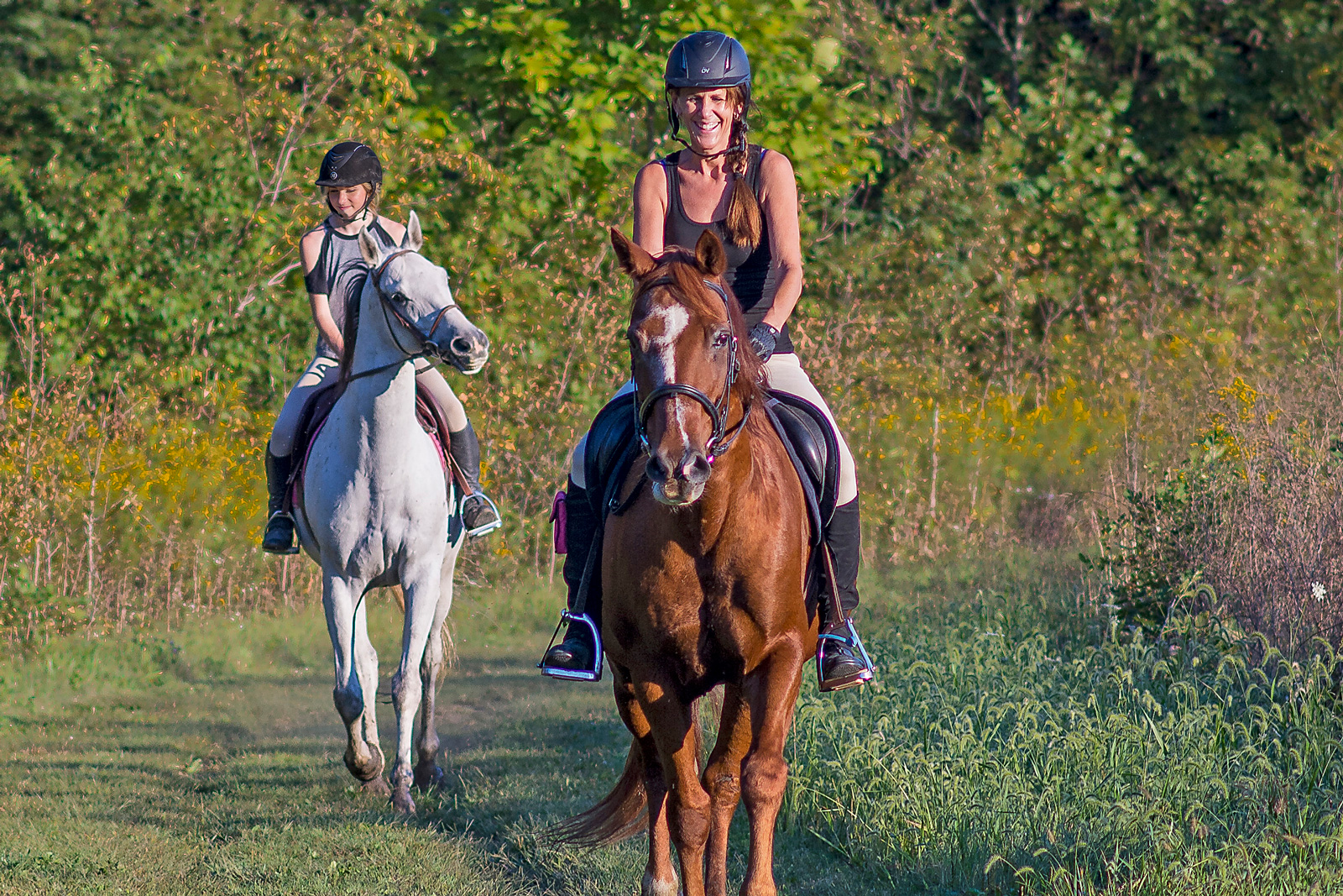 Mother and daughter riding on Bridle Trail at Prairie Oaks.