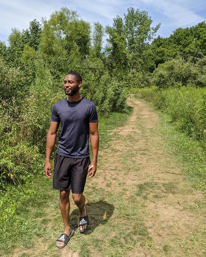Man walks on the Lake View Trail at Prairie Oaks