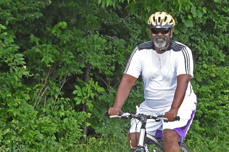 Biker smiling on Blacklick Greenway at Three Creeks Metro Park