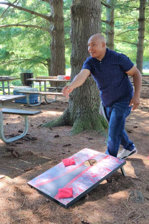 Man playing cornhole at Three Creeks Metro Park
