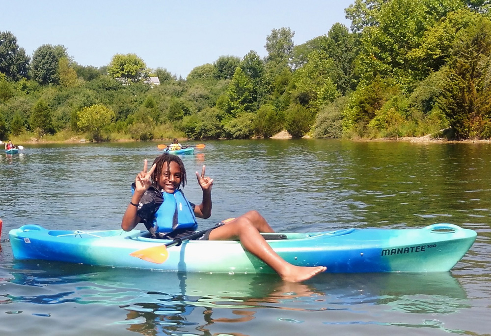A child poses in a kayak at an Outdoor Adventure program at Scioto Grove Metro Park.