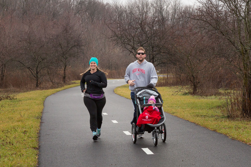 Joggers with stroller on the Beech Woodland Trail at Rocky Fork.